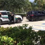 A video screen capture of the felony stop a little after 1 p.m. in the parking lot of Flagler Broadcasting's WNZF radio station. (WNZF video)