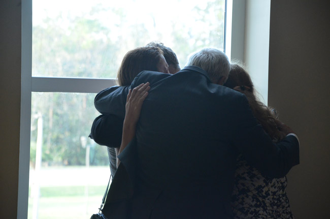 After the verdict Stanley Wykretowicz's father, his wife and one other family member embraced him in an emotional hug outside the courtroom. (© FlaglerLive)