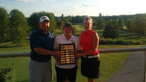Al Costello (left) and Angie Reaney (right) received the OVGA Mixed Bernard and Peggy Turner Davis Trophy from Dianne Illingworth (centre), OVGA Women's Tournament Director(Photo: Marc Ffrench)