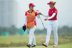 Brooke Henderson and her sister Brittany congratulate each other as they finish the day tied third heading into the third round during the second round at the Rio 2016 Olympic Games, Reserva de Marapendi Golf Course, Barra Da Tijuca, Rio De Janeiro, Brazil. (Photo by Tristan Jones/IGF)