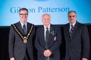 Ottawa mayor Jim Watson (left) and Osgoode Ward Councillor George Derouze (right) present Gibson Patterson (middle) with the Order of Ottawa (Photo: City of Ottawa)