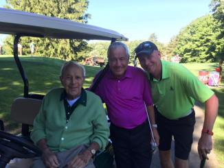 Ron Healy (centre) with Arnold Palmer (left)