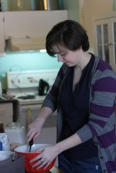 Here is Laura diligently folding in the almond mixture.