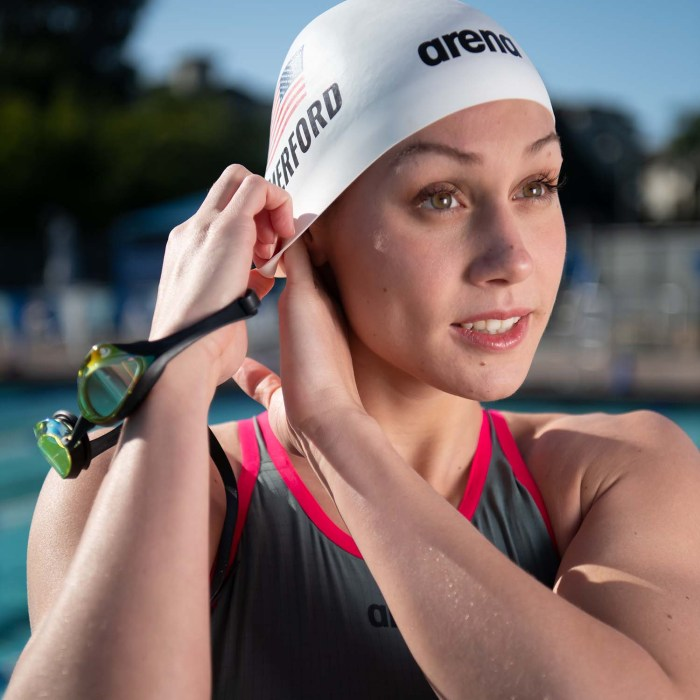 Swimmer and Olympic Hopeful Mallory Comerford puts on her swim cap to join Jill and Alison on Keep the Flame Alive, the podcast for Olympics fans. Photo by Mike Lewis, courtesy of Arena.