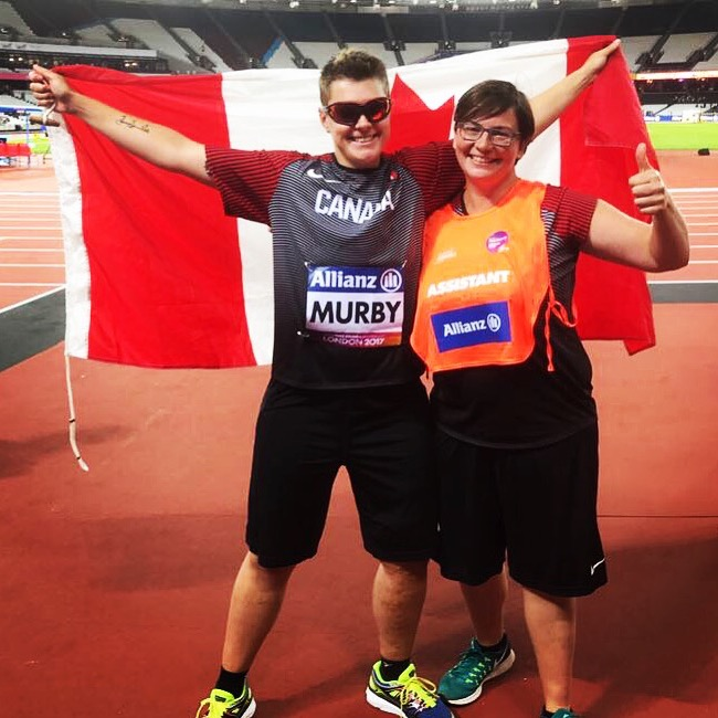 Rio 2016 Paralympic discus thrower Ness Murby and his sports assistant Eva pose with the Canadian flag. Ness talks about the processes he goes through as a visually impaired athlete on this episode of Keep the Flame Alive.
