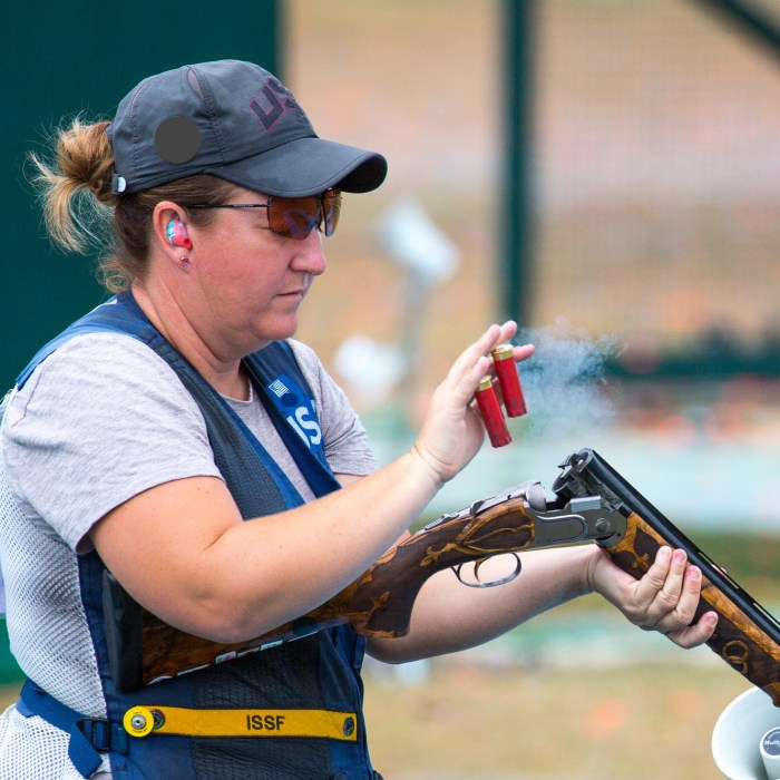 Olympic shotgun shooter Kim Rhode ejects spent shells from her gun at the Rio 2016 Olympics.
