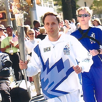 Torchbearer Craig Perlow carries the Olympic torch in the Salt Lake City 2002 Winter Olympics Torch Relay.