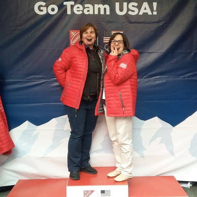 Keep the Flame Alive podcast hosts Jill Jaracz and Alison Brown on the podium and eating Oreos at Team USA's Winterfest celebration, 100 days before the PyeongChang 2018 Winter Olympics.