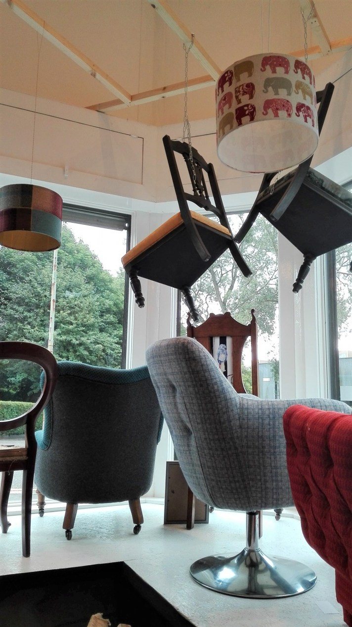 window display with upholstered chairs
