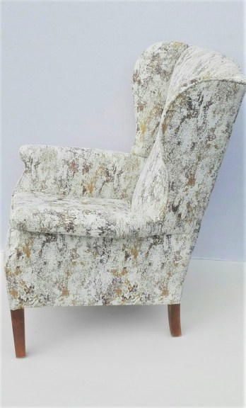 re-upholstered Parker Knoll winged arm chair