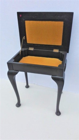 piano stool with upholstered storage in gold velvet