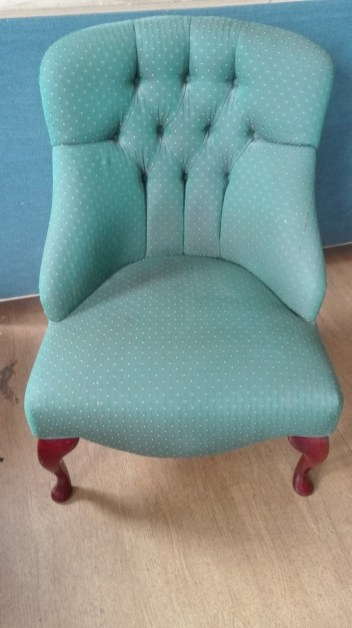 deep buttoned chair before