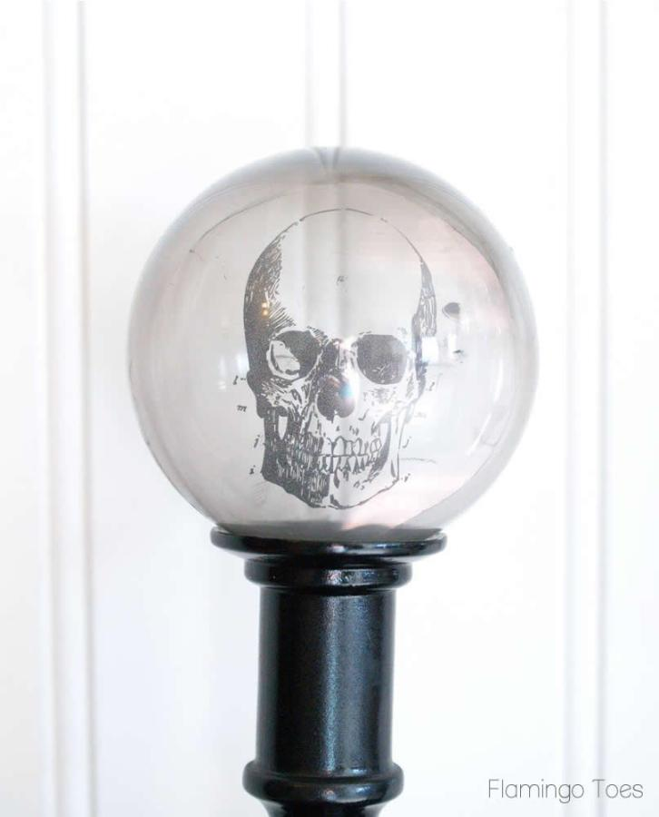 DIY Spooky Crystal Ball Halloween Candlesticks tutorial featured by top US craft blog, Flamingo Toes: Crystal Ball Skull
