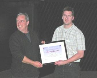 Martin presents Das with a certificate in recognition of his exceptional services to the Campaign for Dark Skies (CfDS) [Pic: Mike Dryland)