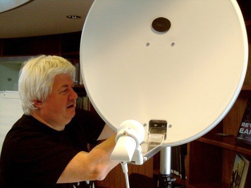 Adrian takes the satellite dish off of its old mount