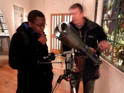 Mike demonstrates a telescope in the telescope workshop