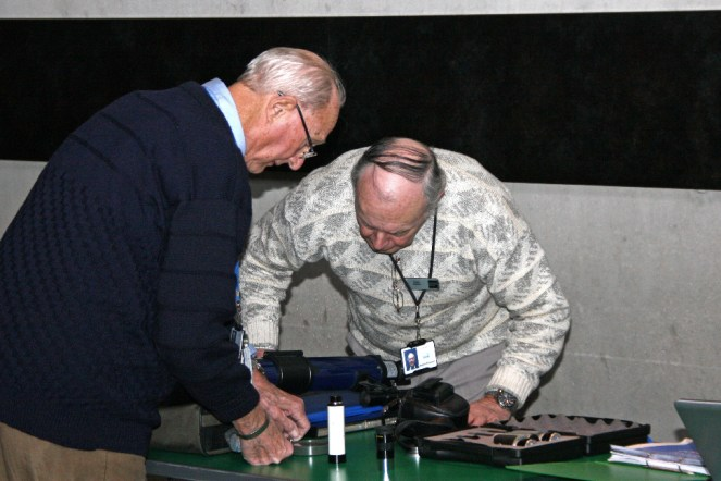 """""""Hmmm... looks like a Tasco telescope to me""""... David and Roger prepare for the workshop"""