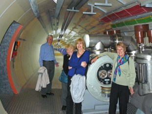 John, Leslee, Pamela and Jane in front of a mock-up of the LHC