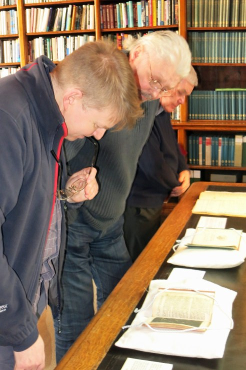 Mike and Brian look at a copy of Galileo's Siderius Nuncius