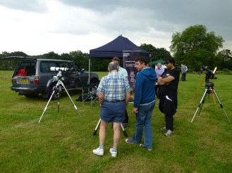 """Telescopes and volunteers around our """"stall"""""""