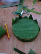 The beginnings of my Krathong. Made with a banana tree trunk banana leaves, and flowers.