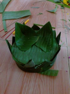 My Krathong in progress. Made with a banana tree trunk banana leaves, and flowers.