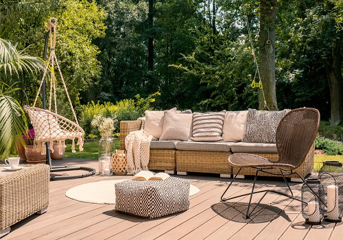 rattan chairs on wooden patio
