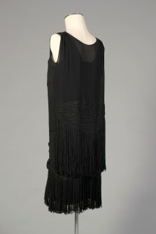 French Export, ca. 1926-1927. Black silk crepe and black embroidery, fringed. It's hem is very high, probably hitting at the knee, as was the fashion in the mid-1920s.