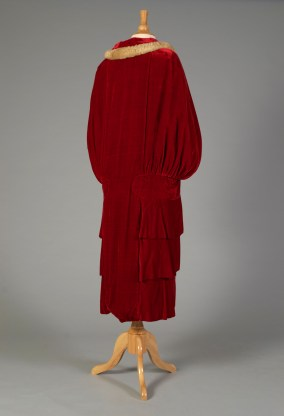 American, ca. 1924. Red velvet cape gathered into wide band at hips with three wide flounces below.