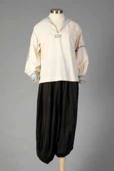 America, ca. 1922. White middy blouse with light blue collar and cuffs, eagle insignia on right sleeve. Black sateen bloomers.