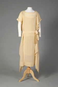 American, ca. 1928. White silk crepe, circular pearl and bead appliqué on inside shoulder.