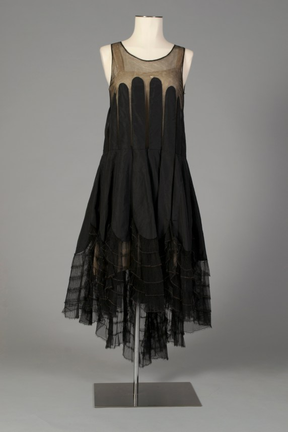 American, ca. 1920. Black thin faille silk with black net, panels of silk applied from bust.