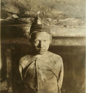 Photograph of a trapper boy in a mine