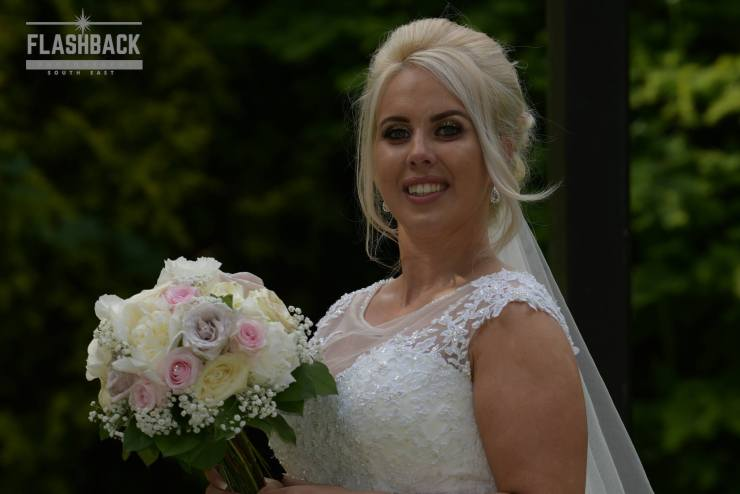 Bride posing with her Bouquet.Kent Sussex Surrey Essex
