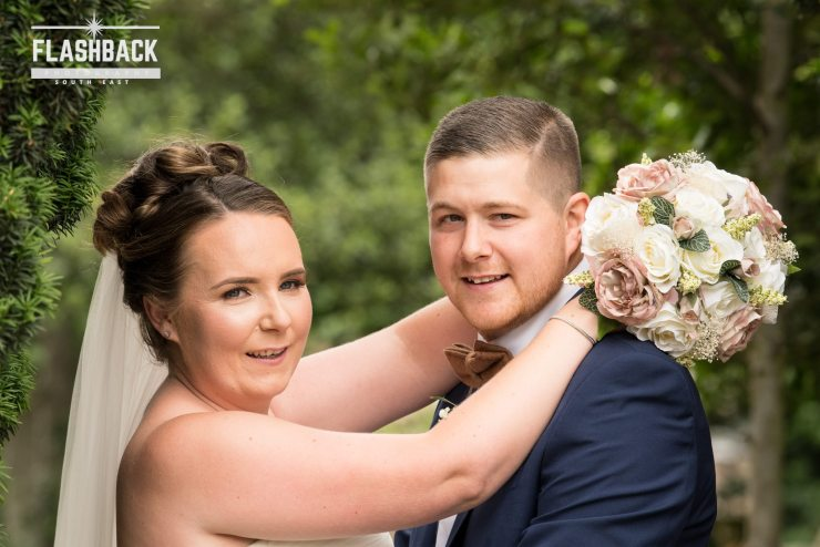 Wedding Gallery - Bride and Groom with bouquet