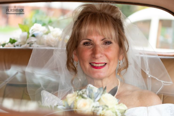 Bride arriving at the church by car