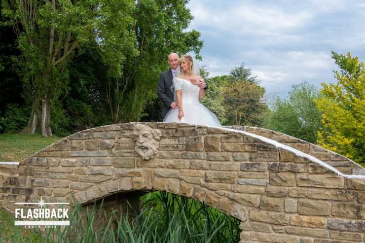Bride and Groom posing on a bridge Kent Sussex Surrey Essex