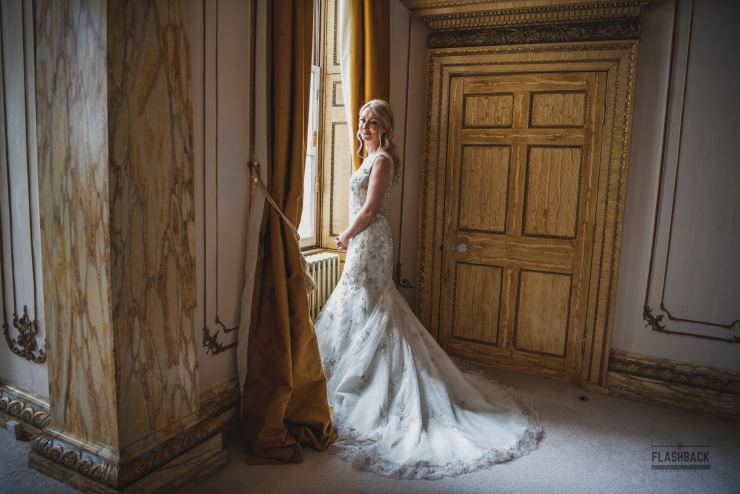 Bride standing outside a window in Essex Kent Sussex Surrey Essex