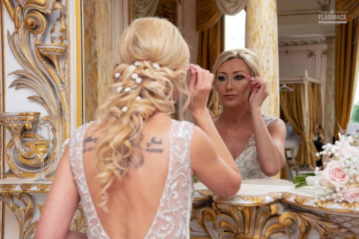 Essex Wedding Photography Bride applying makeup in front the mirror in Essex South East Wedding Gallery Kent Sussex Surrey Essex