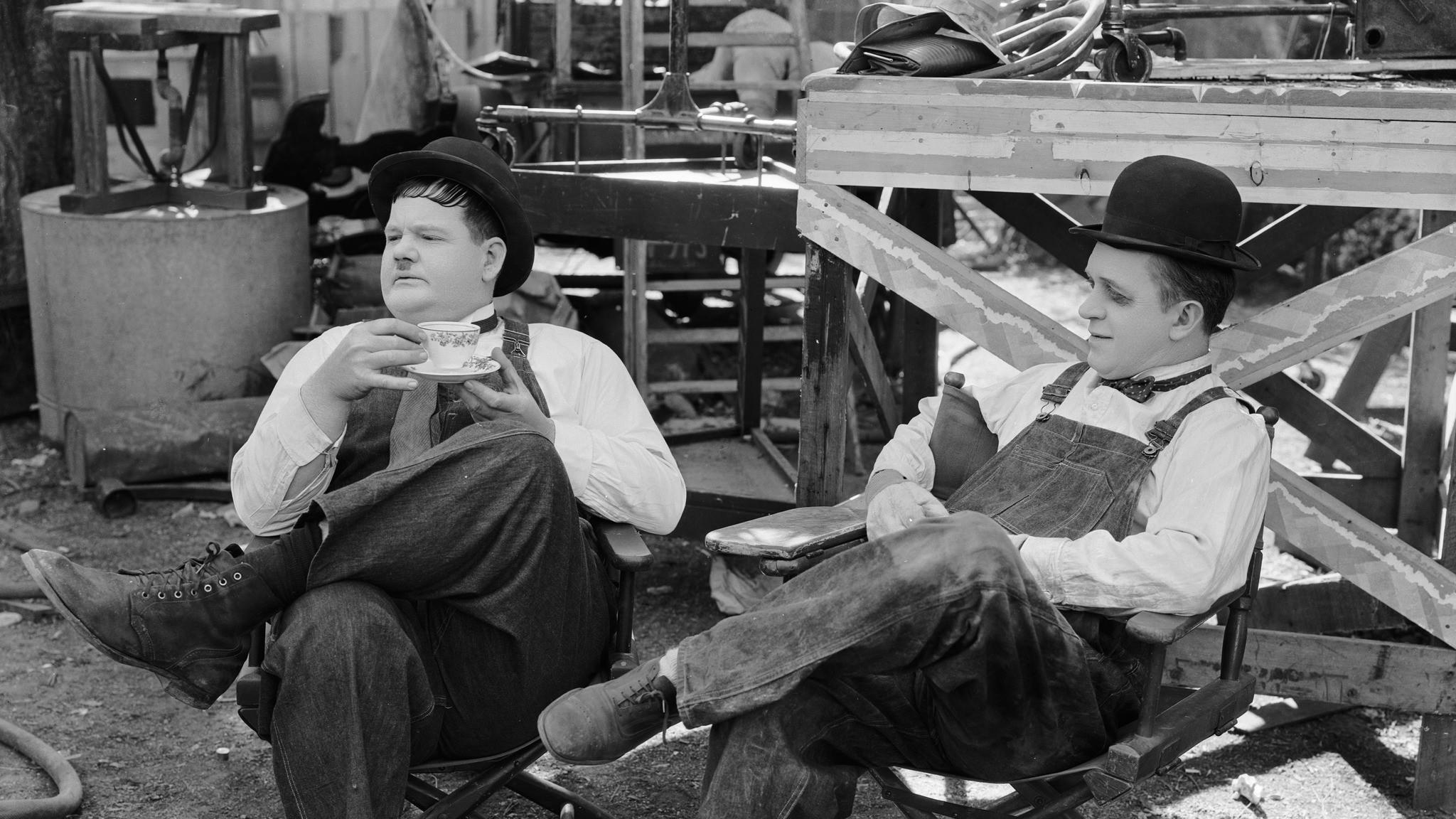 1932 Stan Laurel with a blackened eye and Oliver Hardy during a break in the filming of