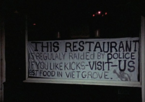 Sign in the window of the much-raided local Caribbean restaurant The Mangrove