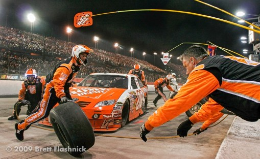 Pit crew members for the #20 Home Depot car driven by Joey Logano, work to execute a pit stop during the NASCAR Sprint Cup Series Southern 500, at Darlington Raceway in Darlington, S.C., Saturday, May 9, 2009. (© 2009 Brett Flashnick/flashnick | visuals)