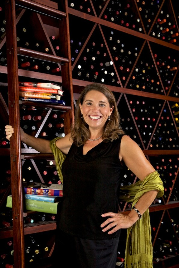 South Carolina Book Festival planner Paula Watkins enjoys a glass of wine and a good book at Hampton Street Vineyard, and a spa afternoon at Occo. in Columbia, S.C., Monday, August 8, 2011. (Brett Flashnick/flashnick visuals, llc.)