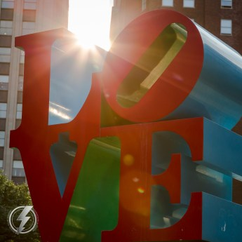 The famous LOVE sculpture by Robert Indiana Is lit by the setting sun at JFK Plaza (aka Love Park) in Philadelphia, PA.