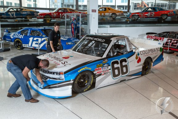 Jordan Anderson, back, and team owner Jeff Bolen, front, polish the #66 Columbia, SC Famously Hot Chevrolet Silverado prior to its unveiling.
