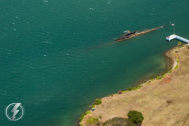 In 1972, a memorial was erected just for the USS Utah off Ford Island, near the sunken wreck. The memorial consists of a 70-foot (21 m) walkway made of white concrete, which extends from Ford Island out to a 40 by 15 ft (12.2 by 4.6 m) platform in front of the ship, where a brass plaque and a flagpole are located. A color guard stands watch over the wreck. On 9 July 1988, Utah and Arizona, the other remaining wreck in the harbor, were nominated to be added to the National Historic Landmark registry. Both wrecks were added to the list on 5 May 1989. As of 2008, seven former crewmen who were aboard Utah at the time of her sinking have been cremated and had their ashes interred in the wreck. © Copyright 2016, Brett Flashnick - All Rights Reserved.