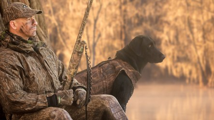 A hunter and his labrador retreiver rest along the banks of Lake Marion in the Sparkleberry Swamp near Wedgefield, SC on Monday, Jan. 21, 2013.