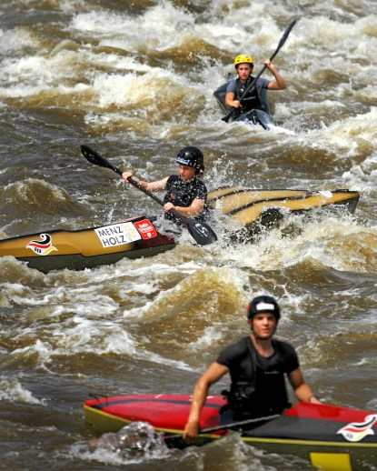 Young, Kyak and Canoe Racers, from around the world practice for the 2007, Junior Wildwater World Championships, Monday, July 16, 2007, at the Millrace Rapids, near Riverbanks Zoo in Columbia, S.C. (© 2007 Brett Flashnick/flashnick   visuals)