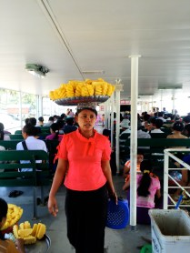 Selling pineapple on the ferry