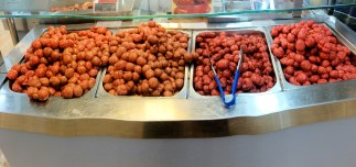 Variety of fresh sausages at grocery store